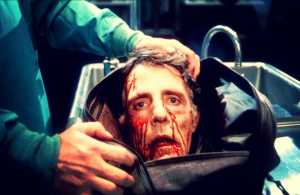 Severed head of Dr. Carl Hill (David Gale) in handbag. Re-Animator