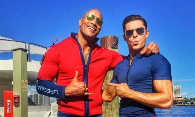 'Baywatch' Teaser Trailer Puts The Rock And Zac Efron In A Comedic Beach Bod Showdown